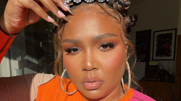 People Cannot Handle Lizzo's Beauty in This Waist-Length Braided Ponytail